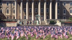Thousands of flags decorate Old Main lawn at Penn State on September 11, 2015. Penn State students placed a flag for each life lost.